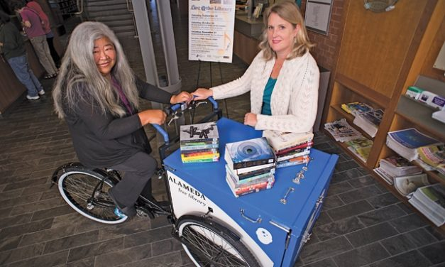 Words on Wheels Distributes Books by Bikes